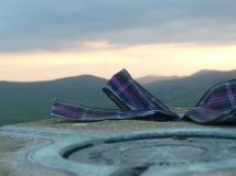 Our ribbon, at a trig point, mountains in the background